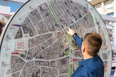 Moscow, Russia - July 24. 2017. Teenager looks at city map. Moscow, Russia - July 24. 2017. A teenager looks at a city map royalty free stock photos