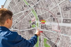 Moscow, Russia - July 24. 2017. Teenager looks at city map. Moscow, Russia - July 24. 2017. A teenager looks at a city map royalty free stock photo