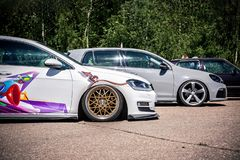 Moscow, Russia: July 06, 2019: Tuned with low suspension, gray Volkswagen Golf 6 and White Golf 7 are in the parking lot on the
