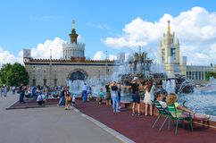 People rest on Exhibition of Achievements of National Economy near fountain Stone Flower, Moscow, Russia. MOSCOW, RUSSIA - JULY 23, 2016: Unknown visitors rest Royalty Free Stock Photography