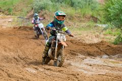 Child on a motorcycle. MOSCOW, RUSSIA - JULY 1, 2017: Unrecognized young athletes, in the Velyaminovo Race Weekend 2017, Motopark Velyaminovo, Istrinsky district stock photo