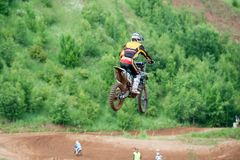 Flying motorcyclist. MOSCOW, RUSSIA - JULY 1, 2017: Unrecognized young athletes, in the Velyaminovo Race Weekend 2017, Motopark Velyaminovo, Istrinsky district royalty free stock photo