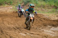 Leaves the chase. MOSCOW, RUSSIA - JULY 1, 2017: Unrecognized young athletes, in the Velyaminovo Race Weekend 2017, Motopark Velyaminovo, Istrinsky district stock photo
