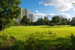 Summer evening in the city Park. MOSCOW, RUSSIA - 23 JULY, 2017: Walking area on a warm summer evening in a recreation area in Altufevo, Moscow Stock Photo
