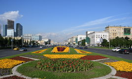 Workers Planting flowers at Triumphal Arc in Moscow, Russia. MOSCOW, RUSSIA - July 21, 2017Workers Planting flowers at Triumphal Arc in Moscow, Russia Royalty Free Stock Photos
