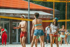 Free Moscow, Russia - June 1, 2014. A Group Of Young Girls And Men In Colorful Clothes Play Beach Volleyball In The Gorky Royalty Free Stock Photo - 171618265