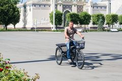 Moscow, Russia - June 24, 2019: Adult man on a modern tricycle in the Park VDNH in Moscow.  stock photo
