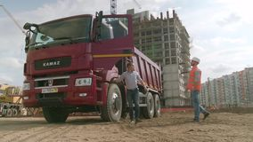 Moscow, Russia - June, 2018: Architects shaking hand at construction site. Scene. KAMAZ driver shakes hands with the stock video