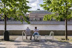 Moscow, Russia, 02 June 2019. Art Museum Park. Elderly and young men sitting in a city Park by the river royalty free stock photos