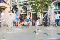 Birzhevaya square. People splash in the fountain in hot weather royalty free stock photos