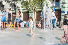 Birzhevaya square. People splash in the fountain in hot weather stock photography