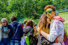 Moscow, Russia - June 3, 2017: Boy and girl, stained with paint, embrace on summer festival of colours Holi stock photography