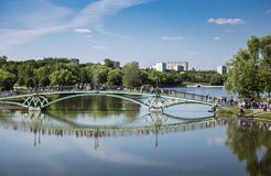 Lake in the park with boats in museum-reserve Tsaritsyno. MOSCOW, RUSSIA - JUNE 16, 2018: Bridge to the Lake in the park in museum-reserve Tsaritsyno stock photos