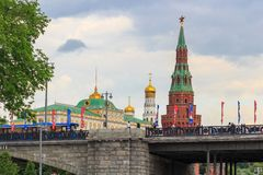Moscow, Russia - June 19, 2018: Buildings of Moscow Kremlin on a background of Bolshoy Kamenny Bridge over Moskva river in cloudy royalty free stock photography