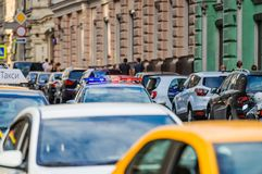 Cars parked on Ilinka street and police car. MOSCOW, RUSSIA - June 29, 2018: Cars parked on Ilinka street and police car stock images