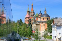Moscow, Russia - June 03, 2018: Church of Great Martyr Barbara with St. Basil`s Cathedral and Moscow Kremlin towers. View from Zar. Yadye Park in Moscow stock images