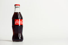 Moscow, Russia - JUNE 9, 2016: Coca-Cola glass bottle. On gray Background Stock Images