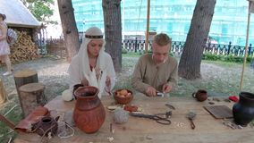 At the festival Times and Epochs. Moscow, Russia, June 09, 2019: At the festival Times and Epochs. The site is dedicated to experimental archeology and crafts of stock footage