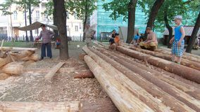At the festival Times and Epochs. Moscow, Russia, June 09, 2019: At the festival Times and Epochs. Wooden logs and woodworking. The site is dedicated to stock video
