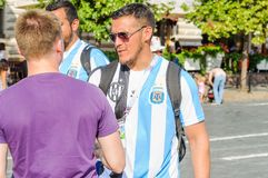 The 2018 FIFA World Cup. Argentine fan in striped white-blue t-shirts in colors of the flag of Argentina on Red square Stock Images