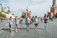 The 2018 FIFA World Cup. Argentine fans in striped white-blue t-shirts in colors of the flag of Argentina go on Red square Stock Images