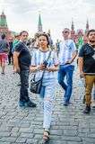 The 2018 FIFA World Cup. Argentine fans in striped white-blue t-shirts in colors of the flag of Argentina on Red square Stock Photos