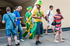 The 2018 FIFA World Cup. Brazilian fans with the flags of Brazil came out of the subway on Bogoyavlensky lane. MOSCOW, RUSSIA - June 29, 2018: The 2018 FIFA royalty free stock photos