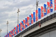 Moscow, Russia - June 21, 2018: Flags with symbols of FIFA World Cup Russia 2018 on the bridge against cloudy sky royalty free stock photos