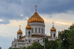 Moscow, Russia - June 19, 2018: Golden domes of Cathedral of Christ the Saviour in Moscow against dramatic sky royalty free stock image