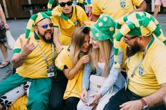 MOSCOW, RUSSIA - JUNE 2018: A group of Brazilian football fans laughing with Russian girls on the street during the royalty free stock images