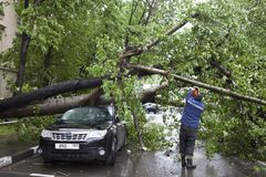 Hurricane in Moscow knocked down trees. The tree fell on an expensive car. MOSCOW, RUSSIA - 26 June, 2017: Hurricane in Moscow knocked down trees. tree fell on royalty free stock photo