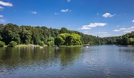 Lake in the park with boats in museum-reserve Tsaritsyno. MOSCOW, RUSSIA - JUNE 16, 2018: Lake in the park with boats in museum-reserve Tsaritsyno royalty free stock images