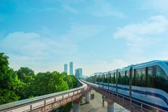 The train of Moscow Monorail. MOSCOW, RUSSIA - JUNE 29, 2013: The line of Moscow Monorail, stretching in direction of Worker and Kolkhoz Woman monument, the stock images