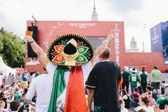 MOSCOW, RUSSIA - JUNE 2018: Mexican fan in uniform and sombrero watching the match Mexico - South Korea on fan fest. MOSCOW, RUSSIA - JUNE 2018 Mexican fan in stock photography