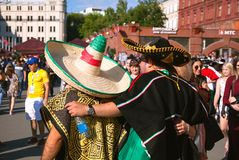 Mexican football fans on red Square in Moscow. Famous Mexican sombreros and ponchos. Football world Cup. MOSCOW, RUSSIA - June 16, 2018: Mexican football fans royalty free stock photo