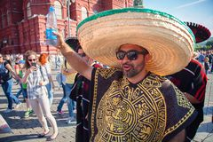 Mexican football fans on red Square in Moscow. Famous Mexican sombreros and ponchos. Football world Cup. MOSCOW, RUSSIA - June 16, 2018: Mexican football fans stock photography