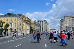 Moscow, Russia, June, 12, 2017, People walking on Mokhovaya street in the summer. Moscow, Russia, people walking on Mokhovaya street in the summer Royalty Free Stock Photo