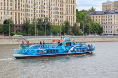 Moscow, Russia - June 21, 2018: Pleasure boat floating on a background Moskva river embankment in historical center of Moscow on a Royalty Free Stock Photo