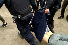Police arrest protesters