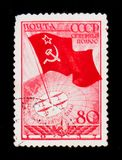 Flag with star, and polar planes on globe, circa 1937. MOSCOW, RUSSIA - JUNE 26, 2017: Rare stamp printed in USSR Russia shows Flag with star, and polar planes Royalty Free Stock Photos