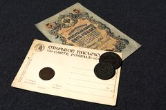 Moscow. Russia. 30 june 2019. Russian banknote 1909 5 rubles and an old postcard of the early 20th century.  stock photo