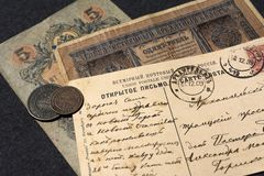 Moscow. Russia. 30 june 2019. Russian banknote 5 and 1 rubles. Real old letter of the beginning of the century with a new Year. Greetings in Russian royalty free stock images