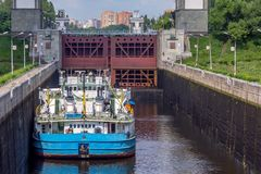 Moscow, Russia - June, 2016. Ship in front of sluice gates. Ship coming through sluice gates of Moscow channel royalty free stock image