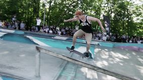 MOSCOW, RUSSIA - JUNE 6, 2015: Skater try make extreme back slid