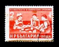 Children playing, Five-Year Plan in Shorter Time Limits serie, circa 1960 Stock Images