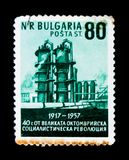 Bulgaria postage stamp shows refinery plant, October revolution 40 anniversary, circa 1957. MOSCOW, RUSSIA - JUNE 26, 2017: A stamp printed in Bulgaria shows stock image