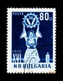 Woman with emblem, 16 agriculture congress, circa 1955. MOSCOW, RUSSIA - JUNE 26, 2017: A stamp printed in Bulgaria shows woman with emblem, 16 agriculture Stock Image