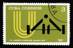 Cuba with a picture of a weight lifter, from the series XX Summer Olympic Games, Munich, 1972, circa 1973 Royalty Free Stock Photo