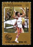 Cuba shows Athlete runner, series devoted to the Montreal Games 1976, circa 1976. MOSCOW, RUSSIA - JUNE 26, 2017: A stamp printed in Cuba shows Athlete runner Stock Images