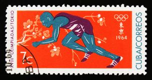 Cuba shows athlete runner, 18th Olympic games in Tokyo, circa 1964 Royalty Free Stock Images